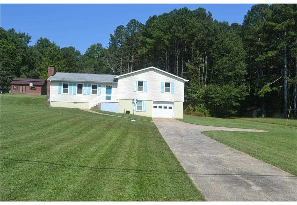 Adorable Split Level Situated On 99 Acre Freshly Painted Interior With New Flooring And