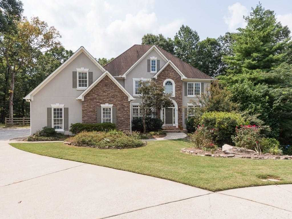 275 Settindown Ct is a homes for sale located in the Foxhall community of Roswell Photo 1