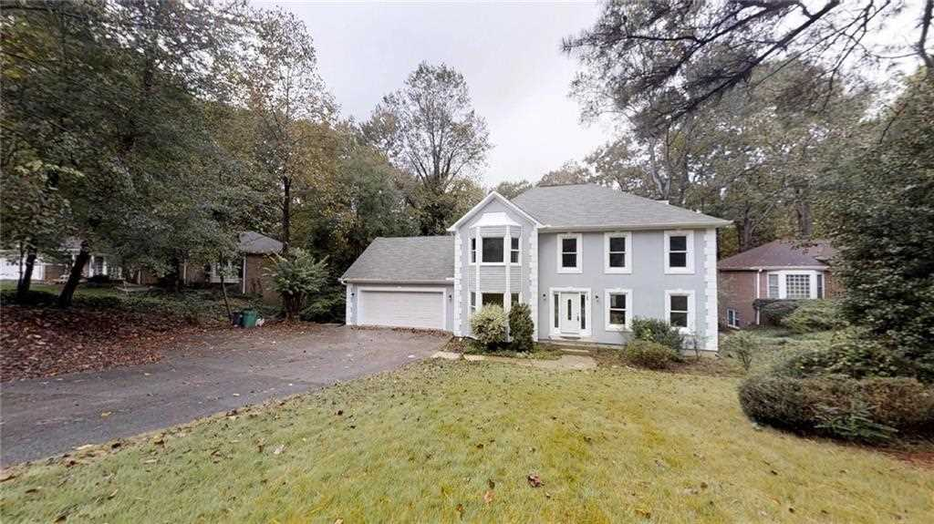 This amazing house sits on over half an acre lot and features 4 ...