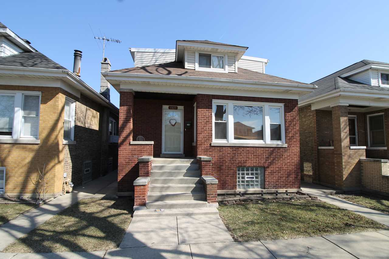 1829 N Lowell Ave Chicago, IL 60639 | MLS 09889411 Photo 1