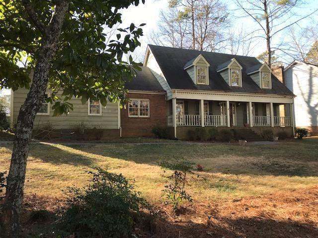 5002 Vernon Oaks Dr, Dunwoody, GA 30338 - Premier Atlanta Real Estate Photo 1