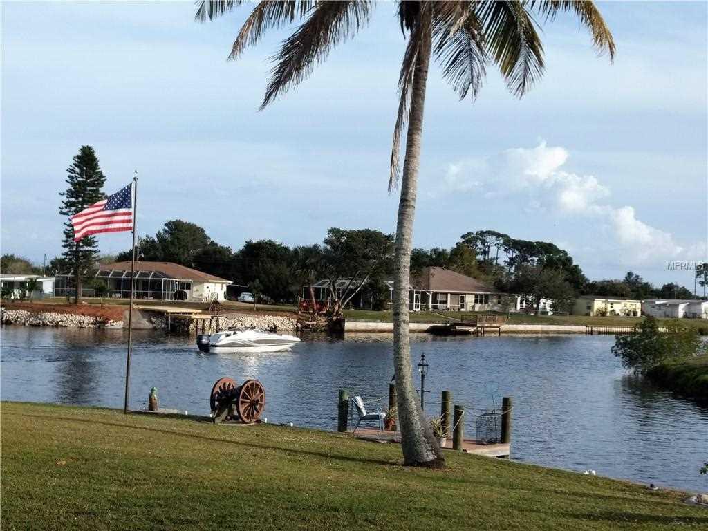 147 NE Concord Drive Port Charlotte, FL 33952 | MLS C7411719 Photo 1