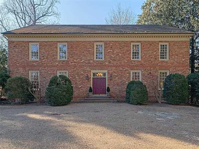 Wiliamsburg inspired brick charmer with hardwoods, triple crown molding,  three levels (one of which   5888050
