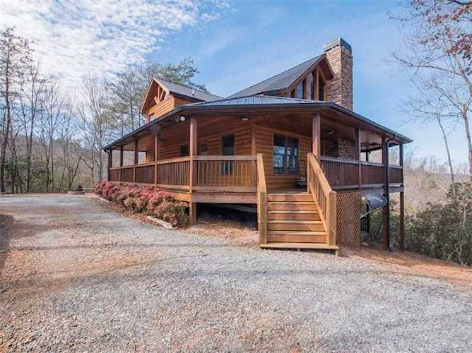 Beautiful log cabin with wrap-around porch, wood-burning fireplace ...