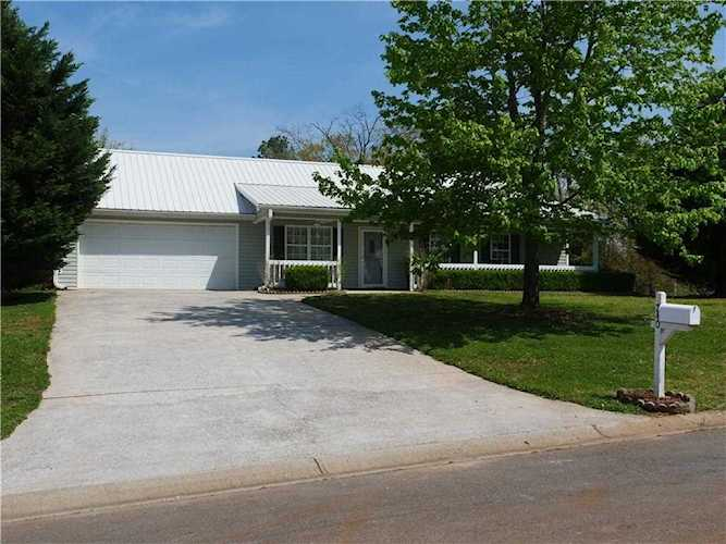 Cute As Button Ranch With Metal Tin Roof And Rocking Chair Front Porch